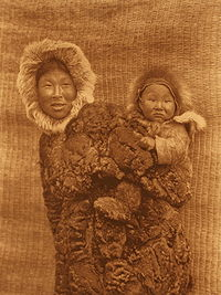 Woman and child -- Nunivak.  Edward S. Curtis, 1930. Northwestern University Library.