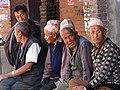 Elderly Men in Plaza - Bhaktapur - Nepal (13487119544).jpg