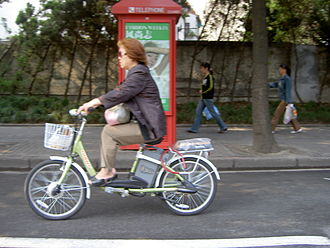 Battery electric vehicle - An e-bike in China. Here the rider isn't using the pedals.
