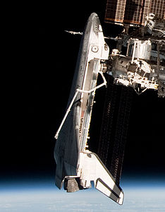 Endeavour from Soyuz TMA-20 (crop) - ISS027-E-036710.jpg
