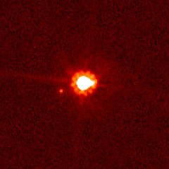Eris (centre) and Dysnomia (left of centre), taken by the Hubble Space Telescope.