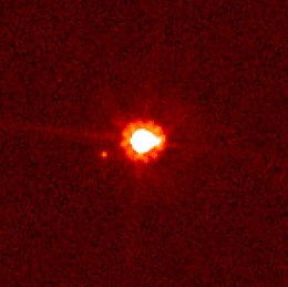Eris (center) and Dysnomia (left of center), taken by the Hubble Space Telescope