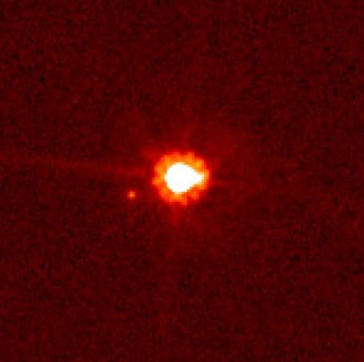Eris (dwarf planet) - Eris (center) and Dysnomia (left of center), taken by the Hubble Space Telescope
