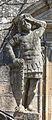 Escultura na parte inferior esquerda das escalinatas da fachada do Obradoiro. Santiago.jpg
