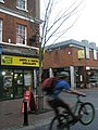 Exuberant cyclist in the High Street - geograph.org.uk - 1604521.jpg