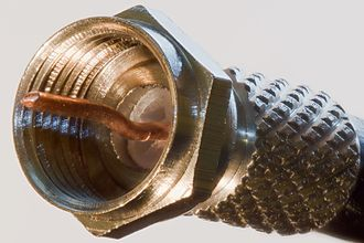 Copper conductor - F connectors attached to coaxial cables are used for TV aerial and satellite dish connections to a TV or set top box.