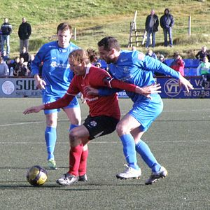 B68 Toftir - Jóhan Dávur Højgaard (in red) from B68 Toftir in a match in Vodafonedeildin in 2010 against FC Suðuroy.