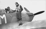 Fenrik Werner Christie at the wing of a Spitfire AH-M BL314.TIF