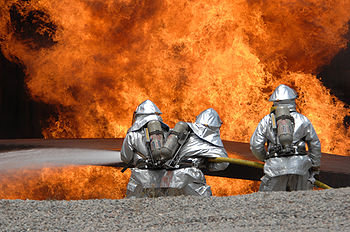 U.S. Air Force Airmen from the 20th Civil Engineer Squadron Fire Protection Flight neutralize a live fire during a field training exercise.