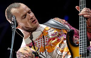 Flea (musician) - Flea performing with Red Hot Chili Peppers at the 2006 Oxegen Festival using his Modulus guitar