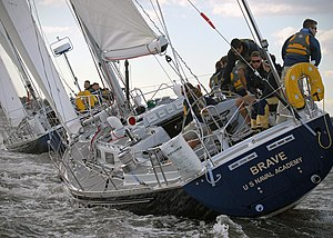 Inter-Collegiate Sailing Association - Members of the U.S. Naval Academy varsity offshore sailing team practice on the Severn River near the academy campus for the McMillan Cup Intercollegiate Regatta