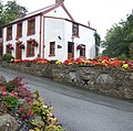 Floral display at Llanychaer post office - geograph.org.uk - 525689.jpg