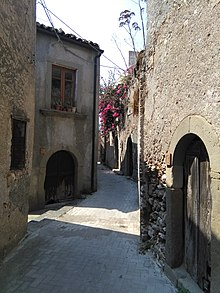 Typical winding medieval lane with traditional houses 544b89ff0dca2