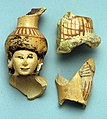 Fragments of a vase in the form of a woman holding a basket MET wb01992.347.jpg