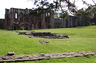 Furness Abbey - View looking across the former guesthouse towards the Cemetery Gatehouse and main church building