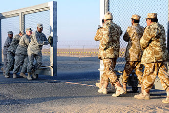 U.S. and Kuwaiti troops closing the gate between Kuwait and Iraq on 18 December 2011 Gate closing Iraq-Kuwait border.jpg
