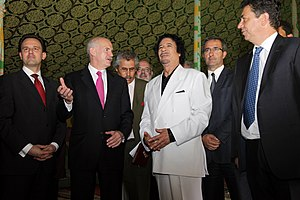 George Papandreou and Muammar Gaddafi, now it'...