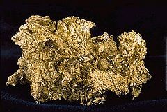 An irregularly shaped nugget of native gold ore.