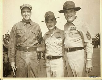 Gomer Pyle, U.S.M.C. - Actual filming was done at the U. S. Marine Corps Recruit Depot (MCRD) San Diego, California 92140 - pictured in the photograph from left to right: Gomer Pyle (Jim Nabors); USMC Representative / MCRD Technical On-Site Advisor (Drill Instructor Edwin J. Kues, USMC); and, Gunnery Sergeant Vince Carter (Frank Sutton).  This photo was taken in between actual filming of the comedy production at MCRD San Diego, California in 1964.