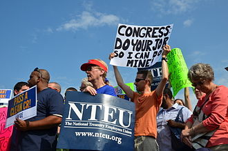 2013 United States federal government shutdown - Federal employees protest the government shutdown at a rally outside of the Capitol
