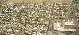 Greenacres, South Australia - Aerial image of eastern end of Greenacres, looking north. The east-west road at the bottom is Muller Road, the Greenacres Shopping Centre is the large complex at bottom right
