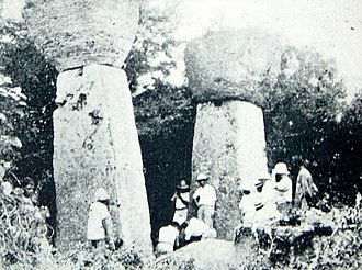 Mariana Islands - Ruins of Guma Taga on Tinian.  The pillars/columns are called latte (pronounced læ'di) stones, a common architectural element of prehistoric structures in the Mariana Islands, upon which elevated buildings were built. Earthquakes had toppled the other latte at this site by the time this photo was taken; an earthquake in 1902 toppled the one seen on the left, and today only the one on the right remains standing.