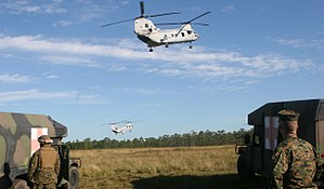 """VMM-264 - Two CH-46 """"Sea Knights"""" soar away as they transport Marines injured in a simulated improvised explosive device attack during a level one and level two casualty evacuation exercise performed by 2nd Medical Battalion, 2nd Marine Logistics Group, at Camp Lejeune on October 31, 2007."""