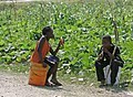 Haitian children chew on sugarcane (4295288743).jpg