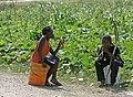 Haitian children chew on sugarcane (4295288743).jpg