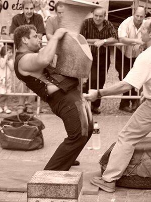 Basque rural sports - A harrijasotzaile lifting the stone.