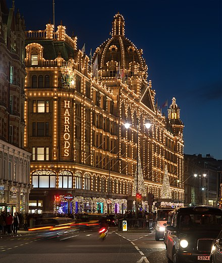 The Harrods building frontage at night