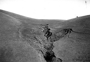 Headward erosion - Headward erosion is demonstrated in this 1906 photo taken near Mount Tamalpais in Marin County, California. Groundwater sapping is causing this gully to lengthen up the slope.