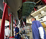 Honorary commanders observe the 18th MXG maintenance facilities 150317-F-QQ371-063.jpg