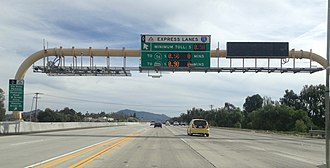 High-occupancy toll lane - FasTrak high-occupancy toll (HOT) lanes along Interstate 15 southbound near Escondido, California. Note the variable fee.