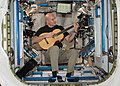 ISS-37 Luca Parmitano plays a guitar in the Harmony node.jpg