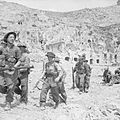 Infantry of the East Surrey Regiment enter the ruins of Cassino, Italy, 18 May 1944. NA14989.jpg