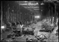 Interior of the old Blacksmiths' Shop at Petone Railway Workshops, 1928 ATLIB 311743.png