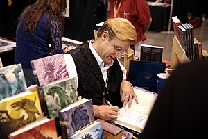 James A. Owen - Owen signing books at the 2017 Phoenix Comicon