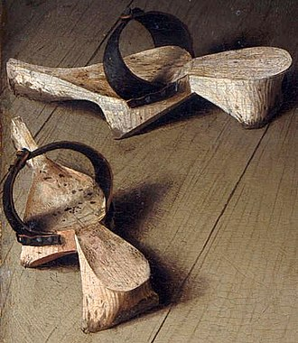 Patten (shoe) - In this detail of the Arnolfini Portrait of 1434, these pattens have been put off inside the house.