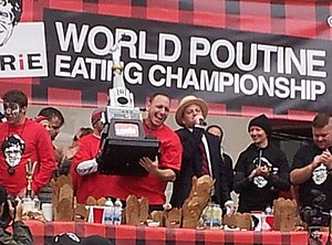 Joey Chestnut - Joey Chestnut lifts the trophy at the 2012 World Poutine Eating Championship in Toronto, Ontario