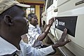 Juba, South Sudan, FEB 2014. Drivers of Oxfam add new stickers on newly aquiered cars..photo- Petterik Wiggers-Panos Pictures (12986968143).jpg