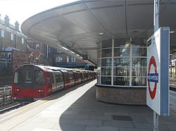 Jubilee Line train at West Hampstead, April 2014 (cropped).jpg