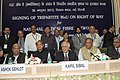 Kapil Sibal at the signing ceremony of MoU with 13 State Governments, in New Delhi. The Chief Minister of Rajasthan, Shri Ashok Gehlot and the Chief Minister of Uttarakhand, Shri Vijay Bahuguna are also seen.jpg