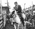 Kennedy campaigns on horseback in Iowa 1960 (cropped1).jpg