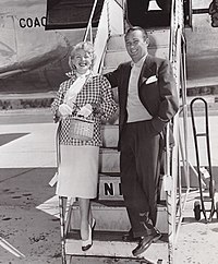 Woman and man exiting a plane