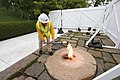 Lighting a torch from the John F. Kennedy Eternal Flame.jpg