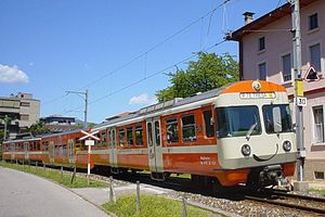 Lugano–Ponte Tresa Railway - One of the current Be4/12 sets with low floor centre car. Note the 'smile'.