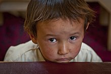 Little boy listens to his teacher in Bamyan, Afghanistan.jpg