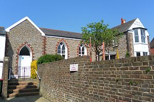 Littlehampton Friends Meeting House - The entrance, in a slightly projecting bay, is set under a pointed arch.