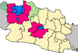 Jabodetabek - Jabodetabek on left in blue and magenta; Greater Bandung on right, Jakarta and 4 cities in blue, 3 suburban regencies in magenta, green diagonals mark sprawl areas outside Jabodetabek: Serang and Karawang Regencies